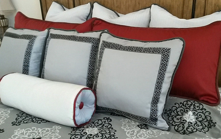Black, grey and red pillows and bolster
