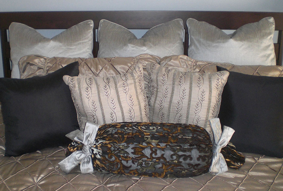 Black, silver and gold pillows and bolster
