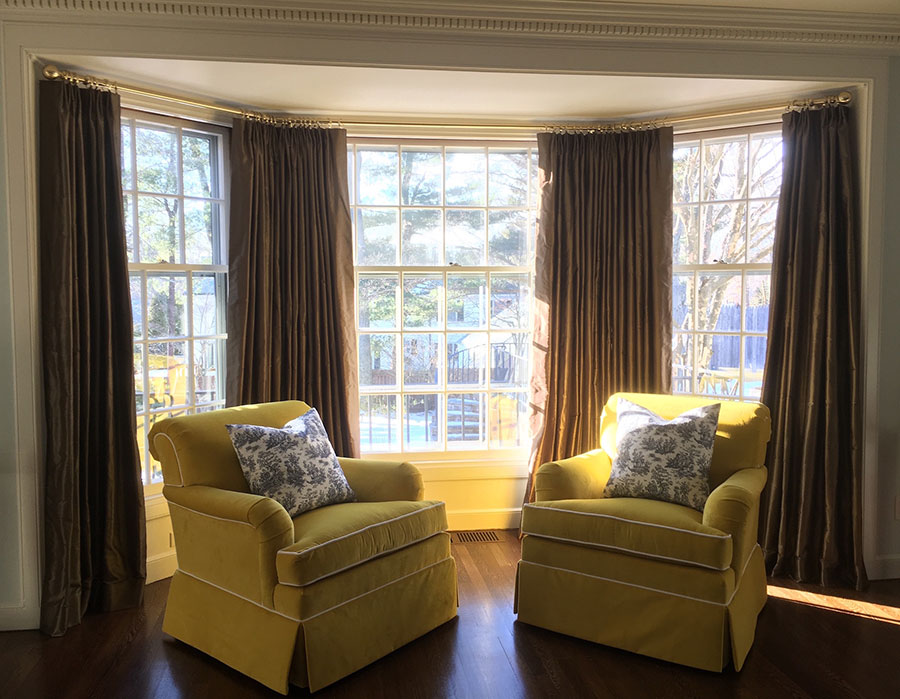 Brown silk drapes with yellow chenile chairs