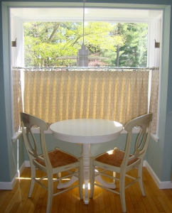 Cafe drapes in cream with table and chairs