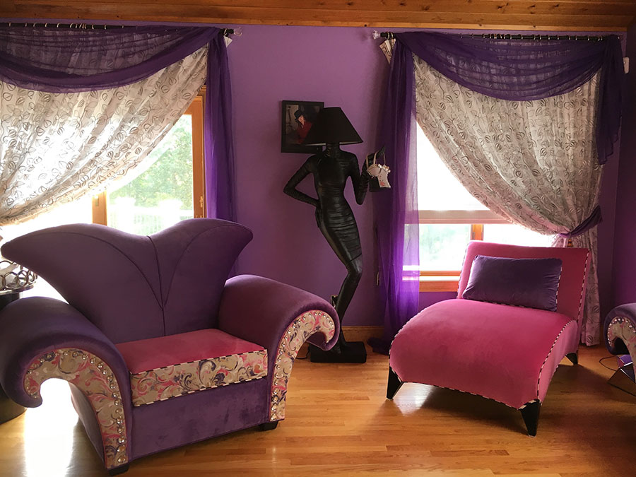 Purple velvet wing chair with pink lounge chair