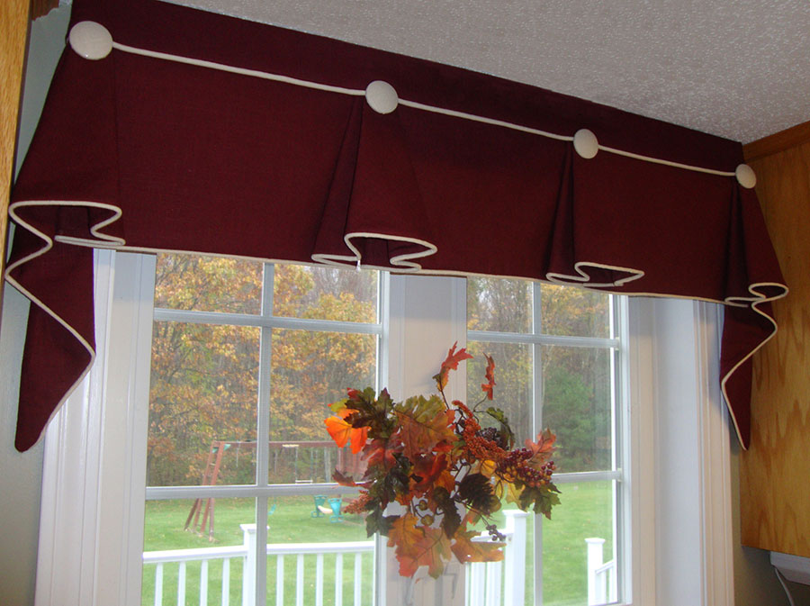 red valance with white cording